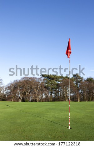 golf flag in the 18th hole - stock photo