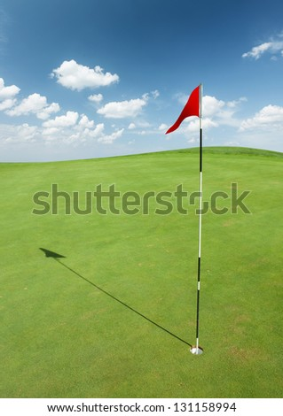 Golf flag on green grass - stock photo
