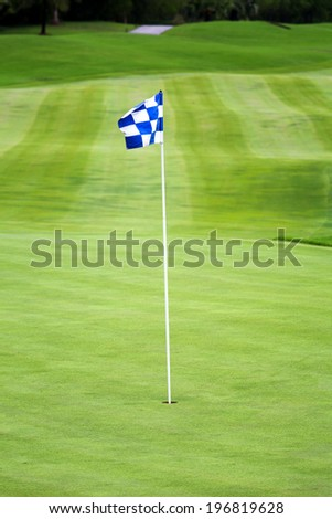 Golf flag spread on the wind - stock photo