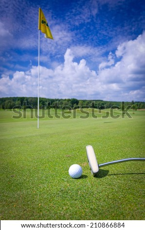 Golf green composition with flag and putter