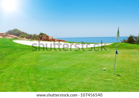 Golf green field on the background of the sea. In the summer in Portugal. - stock photo