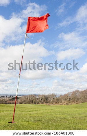 Golf green in a sunny day - stock photo