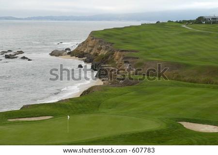 golf green on ocean - stock photo