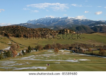 Golf green with Sierra del Cadi view - stock photo