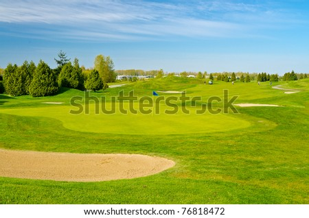 Golf place with gorgeous green and blue sky view