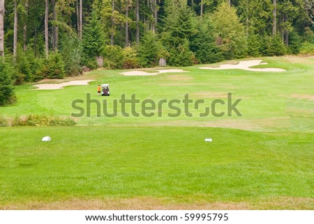 Golf place with nice green and bunkers.