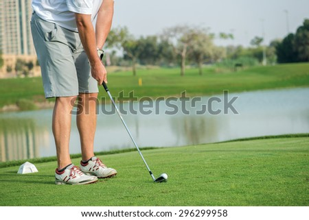 Golf player hit a golf ball with a golf club. Golf courses. Players are trained to play golf on the golf course. Close-up of a golf club and ball - stock photo