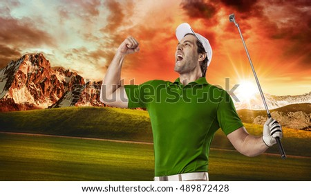 Golf Player in a green shirt celebrating, on a golf course.