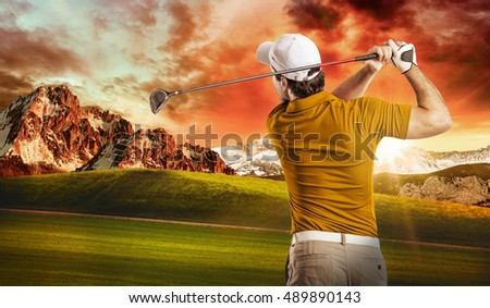 Golf Player in a orange shirt taking a swing, on a golf course.