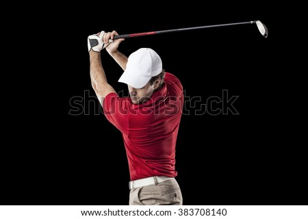 Golf Player in a red shirt taking a swing, on a black Background. - stock photo