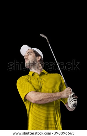 Golf Player in a yellow shirt taking a swing, on a black Background.