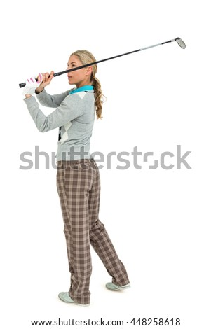 Golf player taking a shot on white background