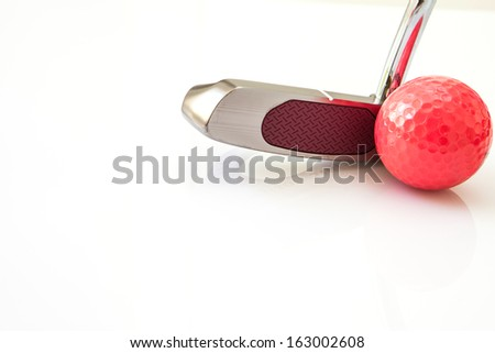 Golf putt and red ball in white background