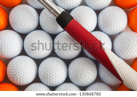 Golf putter and different golf balls - stock photo