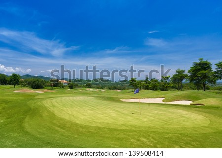 golf putting green with purple flag.