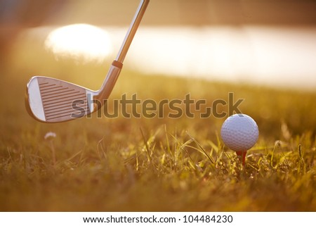Golf Stick and Ball on the Grass - stock photo