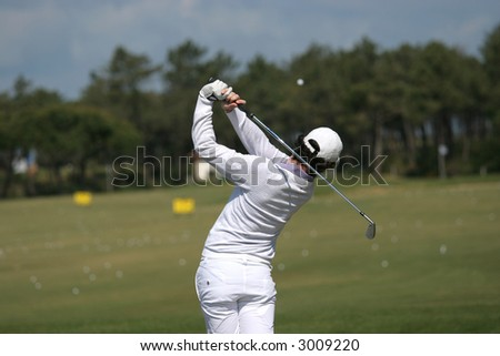 golf swing in oitavos, portugal - stock photo