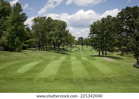 Golf tee box and fairway on sunny day