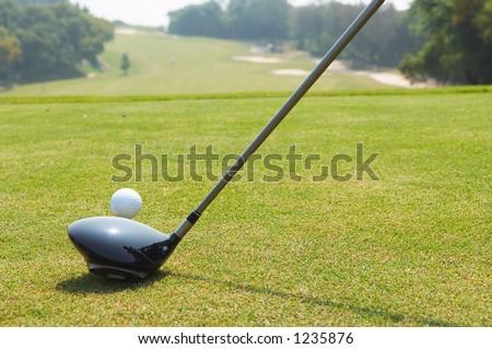 Golf teeing off with a driver - stock photo