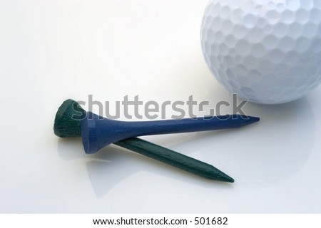 Golf tees with a golf ball