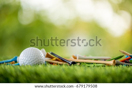 golf tees with ball on green field