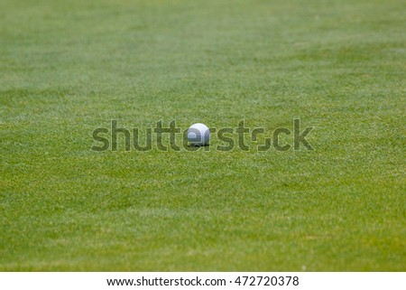 Golfball on grass  - on the green