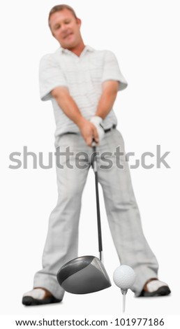 Golfer about to swing against a white background