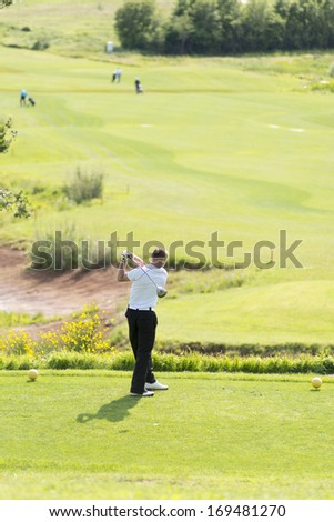 Golfer after the swinging the club - stock photo