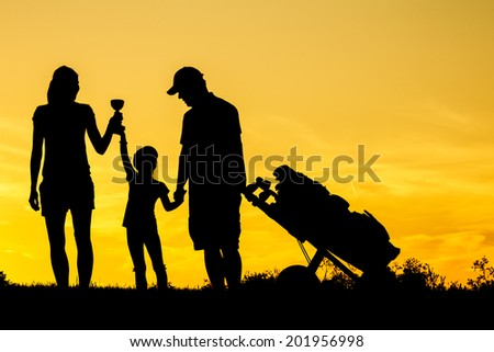 Golfer at sunset - stock photo