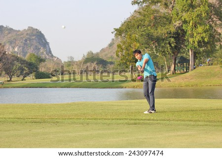 Golfer chipping onto the green - stock photo