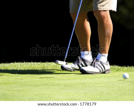 Golfer close to target - stock photo