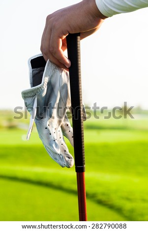 Golfer hand on Golf Club - stock photo