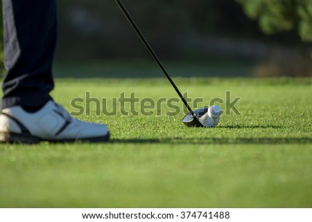 Golfer hitting driver club on course for tee shot. - stock photo