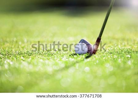 Golfer hitting iron club on golf course on fairway. - stock photo