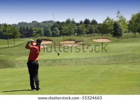 golfer hitting the ball - stock photo