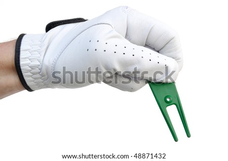 Golfer Holding a Green Ball Mark Repair Tool (or Pitchfork) - stock photo