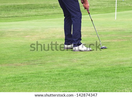 Golfer making the perfect putt.