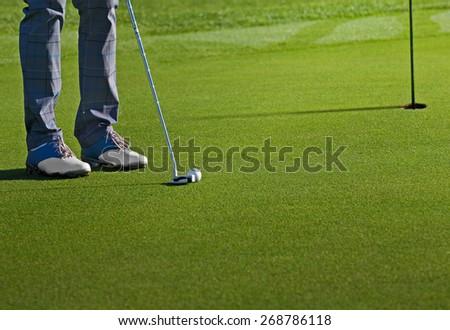 golfer on green - stock photo