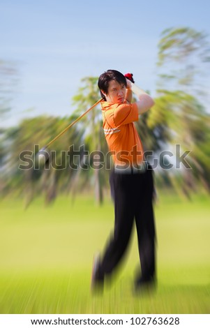 Golfer shooting a golf ball - stock photo