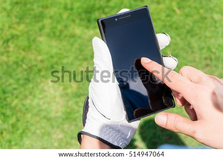 Golfer using application on smart phone