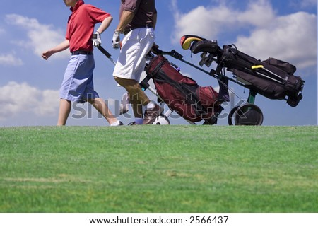 golfer walking - stock photo