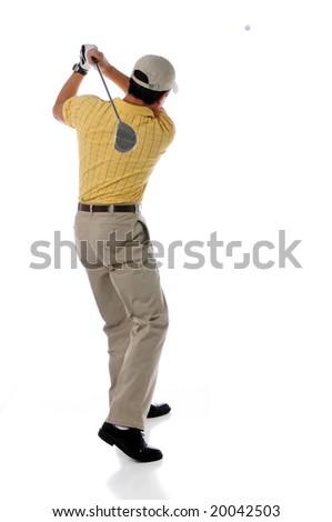 Golfer watching ball after swinging - stock photo