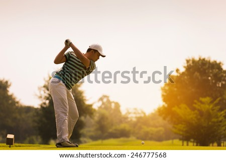 Golfers are going to hit a golf ball. On the golf course during the summer - stock photo