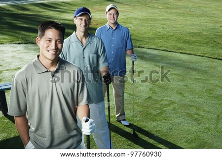 Golfers posing together - stock photo