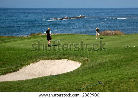 Golfing By The Sea - stock photo