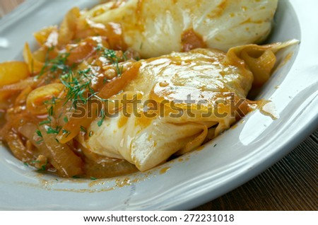 Golumpki  - cabbage roll common in Polish cuisine.made from  boiled cabbage leaves wrapped around minced pork or beef, chopped onions, and rice,  baked in a casserole dish. - stock photo