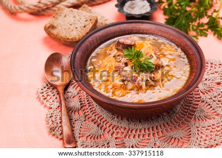 Gombaleves - Chrismtas hungarian soup with sauerkraut, sausages, mushrooms and barley - stock photo