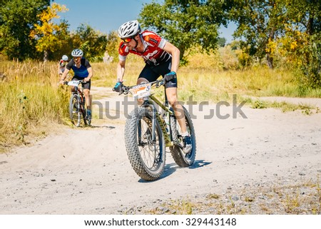 Gomel, Belarus - August 9, 2015: Group of mountain bike cyclists riding track at sunny day, healthy lifestyle active athlete doing sport. - stock photo