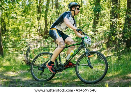 Gomel, Belarus - August 9, 2015: Mountain Bike cyclist riding track at sunny day, healthy lifestyle active athlete doing sport - stock photo