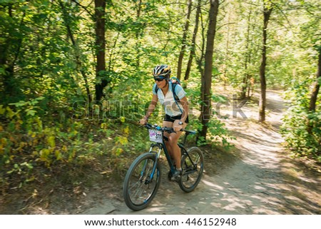 Gomel, Belarus - August 9, 2015: Mountain Bike cyclist riding track at sunny day, healthy lifestyle active athlete doing sport. Blurred motion background - stock photo